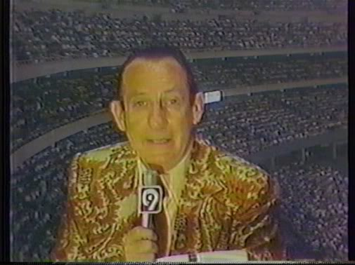 The Mets' Lindsey Nelson in colorful pre-Craig Sager attire.